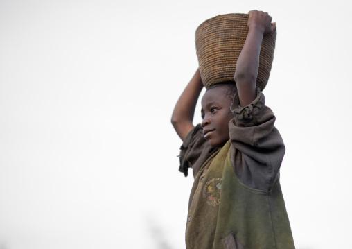Rwandan child carrying stuff on his head, Northwest Province, Rehengeri, Rwanda