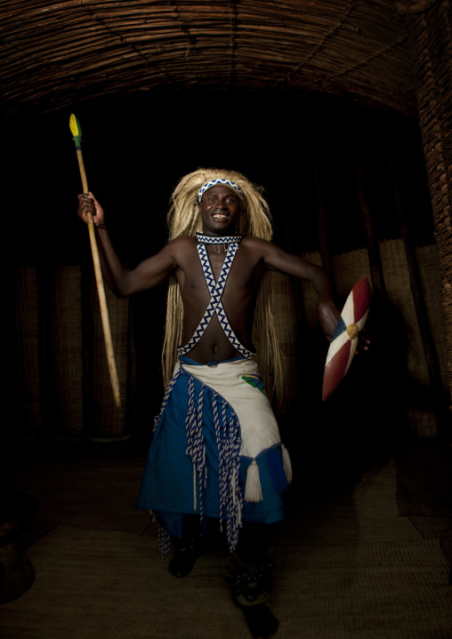 Traditional intore dancer with a shield during a folklore event in a village of former hunters, Lake Kivu, Ibwiwachu, Rwanda