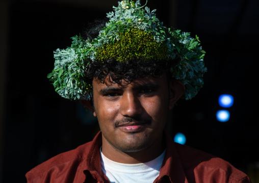 Portrait of a flower man wearing a floral crown on the head, Jizan province, Sabya, Saudi Arabia