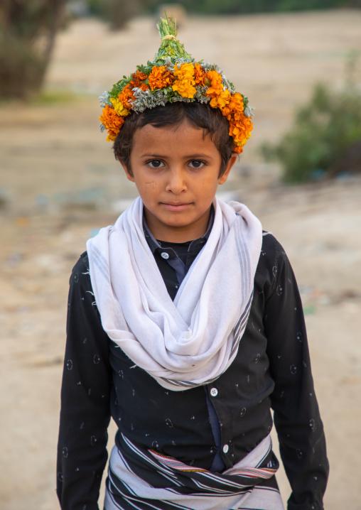 Portrait of a flower boy wearing a floral crown on the head, Jizan province, Alaydabi, Saudi Arabia