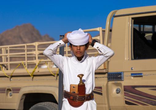 Portrait of a saudi boy wearing a white tradtional clothing, Najran Province, Najran, Saudi Arabia