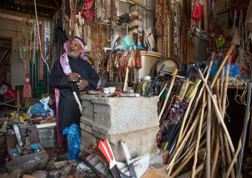 Saudi man selling antique stuff in a shop, Najran Province, Najran, Saudi Arabia