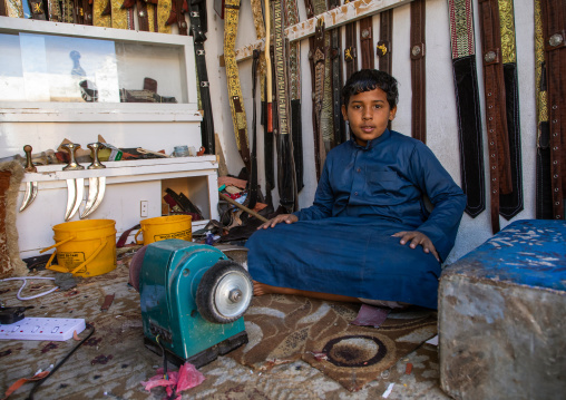 Yemeni refugee boy making jambiyas in a shop, Najran Province, Najran, Saudi Arabia