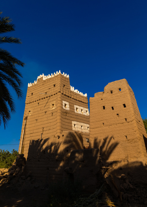 Traditional old multi-storey mud house in the middle of plam trees, Najran Province, Najran, Saudi Arabia