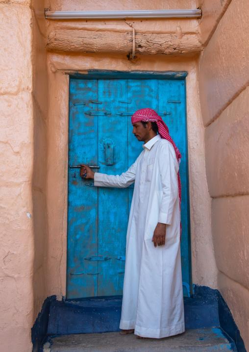 Saudi man at the entrance of his traditional house, Najran Province, Najran, Saudi Arabia