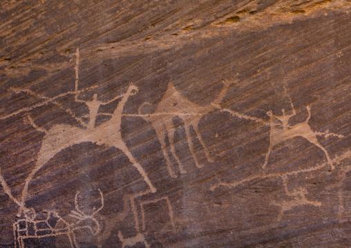 Petroglyphs of men hunting camels on horses, Najran Province, Minshaf, Saudi Arabia