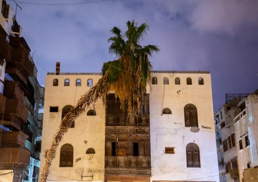 Historic house with wooden mashrabiyas in al-Balad quarter at night, Mecca province, Jeddah, Saudi Arabia