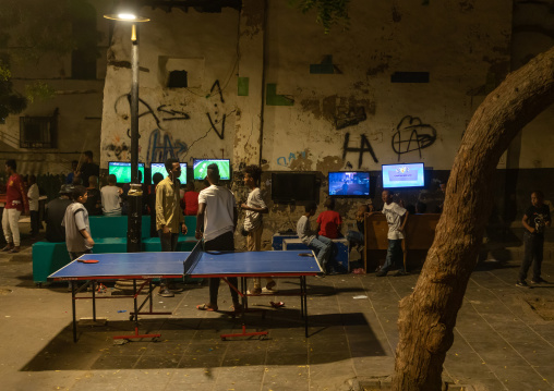 Somali refugees children playing video games in the street in al-Balad quater, Mecca province, Jeddah, Saudi Arabia