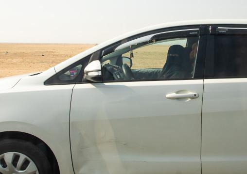 Saudi woman driving alone in a car on the highway, Mecca province, Jeddah, Saudi Arabia