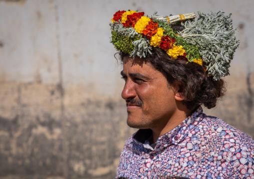 Portrait of a flower man wearing a floral crown on the head, Jizan Province, Addayer, Saudi Arabia