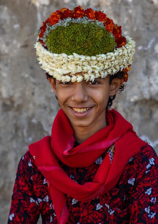 Portrait of a smiling flower boy wearing a floral crown on the head, Jizan Province, Addayer, Saudi Arabia