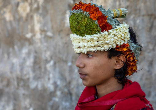 Portrait of a flower boy wearing a floral crown on the head, Jizan Province, Addayer, Saudi Arabia