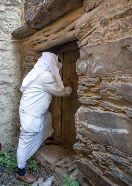 Saudi man entering an old house, Jizan Province, Addayer, Saudi Arabia