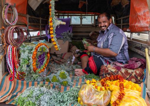 A flower vendor preparing floral garlands and crowns on a market, Jizan Province, Addayer, Saudi Arabia