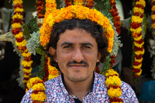 A flower vendor with floral garlands and crowns on a market, Jizan Province, Addayer, Saudi Arabia