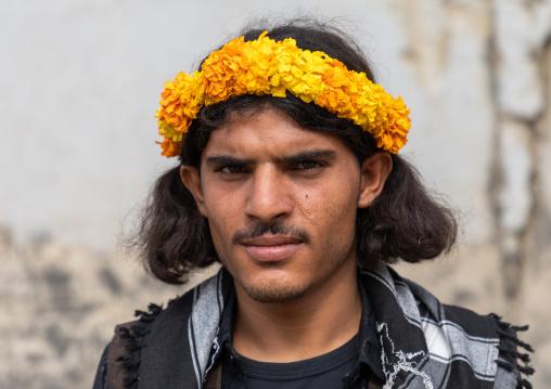 Portrait of a flower man wearing a yellow floral crown on the head, Jizan Province, Addayer, Saudi Arabia