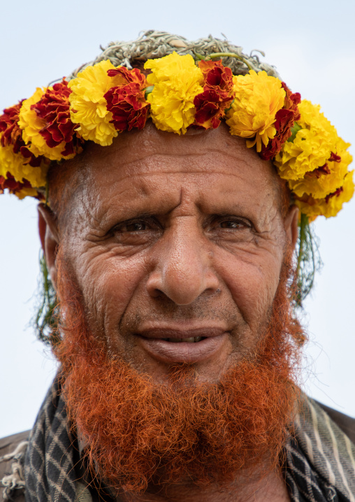 Portrait of a flower man with a red beard wearing a floral crown on the head, Jizan Province, Addayer, Saudi Arabia