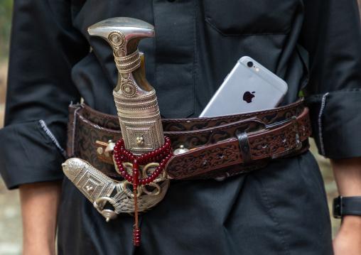 Saudi man with an iphone and a janbiya in his belt, Jizan Province, Jebel Qahar, Saudi Arabia