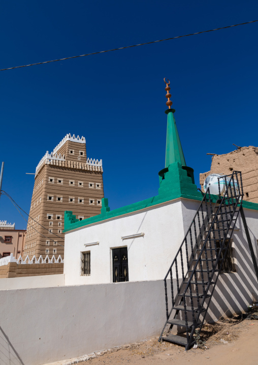 Mosque in front of a traditional old mud house, Najran Province, Najran, Saudi Arabia