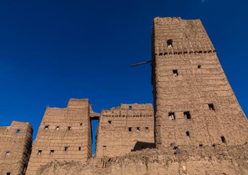 Old village of traditional mud houses against blue sky, Asir province, Dhahran Al Janub, Saudi Arabia
