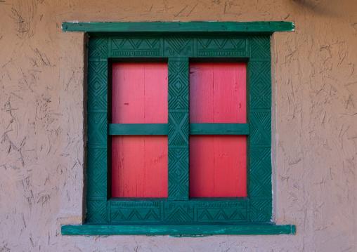 Colorful wooden wondow of an asiri house, Asir province, Khamis Mushait, Saudi Arabia