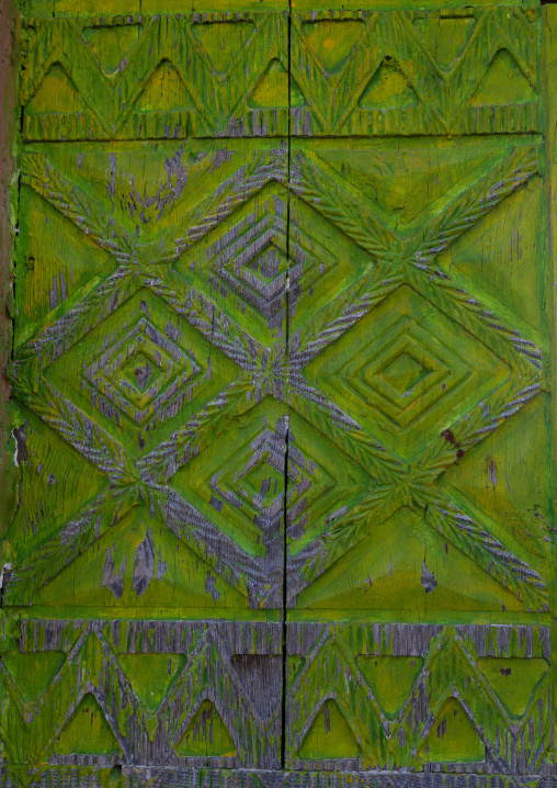 Green wooden door of an old asiri house, Asir province, Khamis Mushait, Saudi Arabia