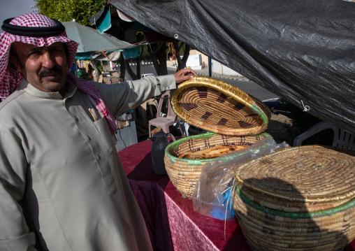 Saudi man buying bread in the women market, Asir province, Abha, Saudi Arabia