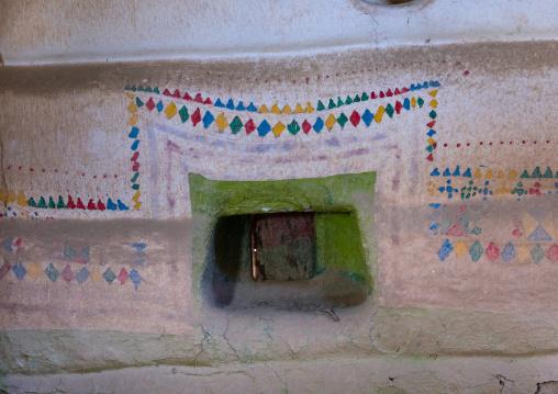 Al-qatt al-asiri traditionally female interior window decoration in an abandonned house, Asir province, Sarat Abidah, Saudi Arabia