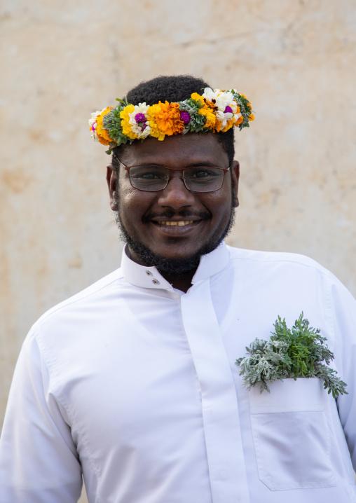 Portrait of a flower man wearing a floral crown on the head, Asir province, Muhayil, Saudi Arabia