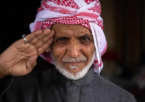 Portrait of saudi man with a keffieh saluting, Asir province, Tanomah, Saudi Arabia