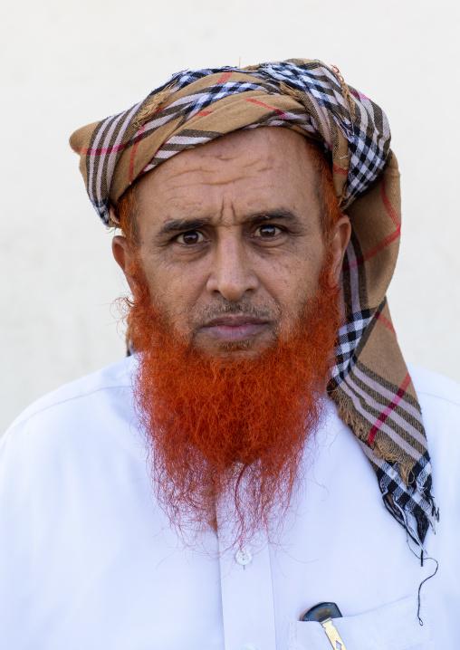 Portrait of a saudi man with a red beard and a burberry style keffieh, Jizan Province, Addayer, Saudi Arabia
