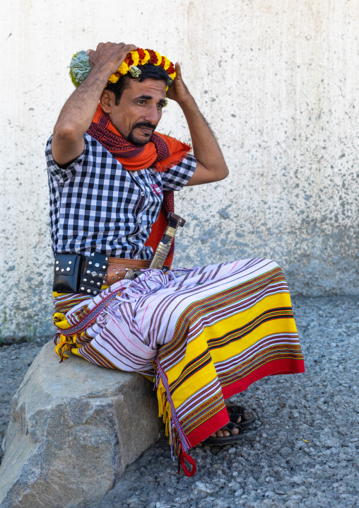 Portrait of a flower man making a floral crown on his head, Jizan Province, Addayer, Saudi Arabia