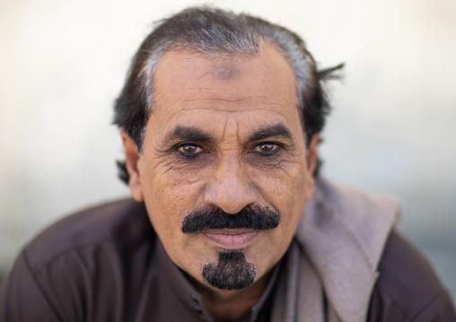 Portrait of a saudi man with kohl on his eyes, Jizan Province, Addayer, Saudi Arabia