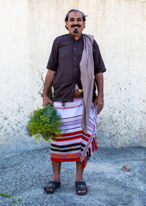 Portrait of a flower man with a floral crown in the hand, Jizan Province, Addayer, Saudi Arabia