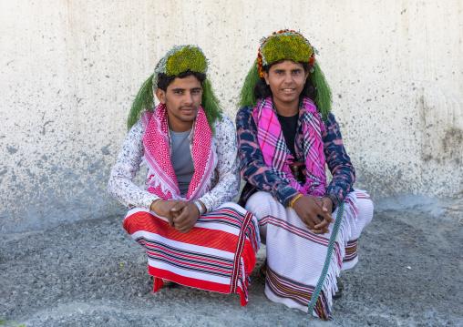 Portrait of flower men wearing floral crowns on the heads, Jizan Province, Addayer, Saudi Arabia