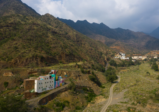 Aerial view of an old traditional house with 2030 logo on the facade, Asir province, Rijal Alma, Saudi Arabia