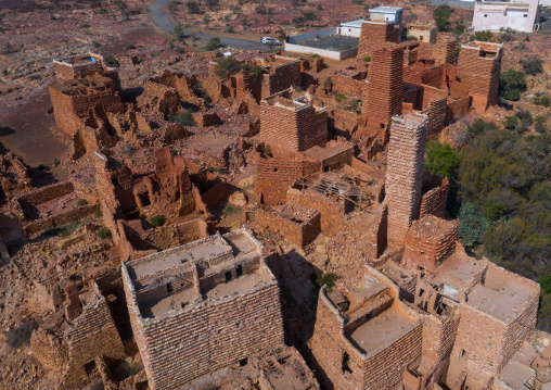 Aerial view of red stone and mud houses with slates in a village, Asir province, Sarat Abidah, Saudi Arabia