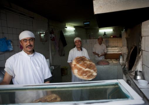 Men making bread, Asir province, Sarat Abidah, Saudi Arabia
