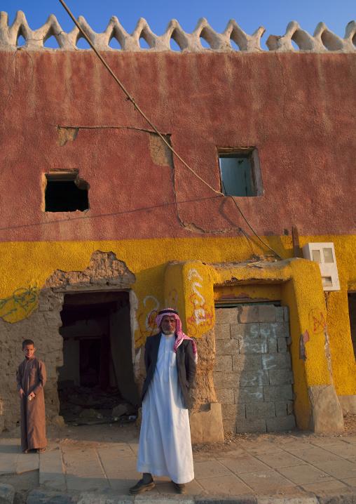 Saudi men in front of an old house, Najran Province, Najran, Saudi Arabia