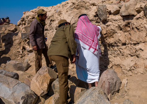Saudi men searching old bones on al ukhdud site, Najran Province, Najran, Saudi Arabia