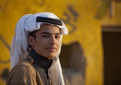 Portrait of a saudi teenager wearing a keffieh, Najran Province, Najran, Saudi Arabia
