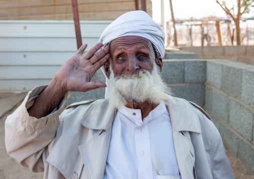 Saudi man eating his beard to make a joke, Najran Province, Najran, Saudi Arabia