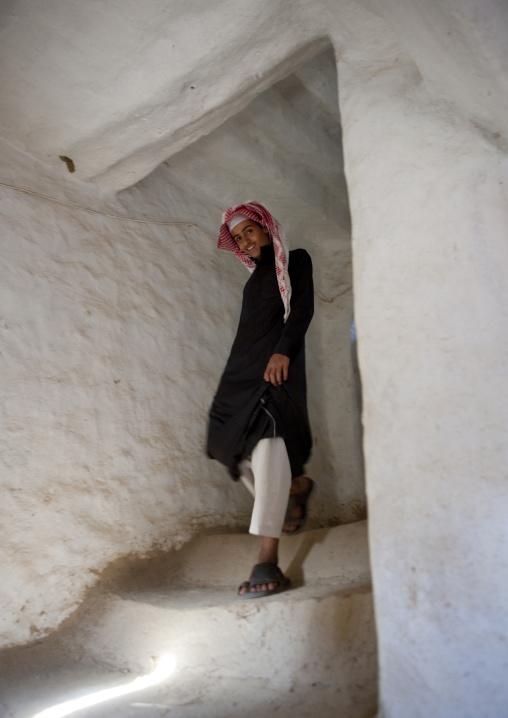 Portrait of a saudi man wearing a keffieh in stairs, Najran Province, Najran, Saudi Arabia
