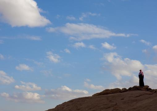 Saudi man on the top a hill, Al-Jawf Province, Sakaka, Saudi Arabia