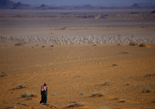 Saudi man walking in the desert, Al Madinah Province, Alula, Saudi Arabia