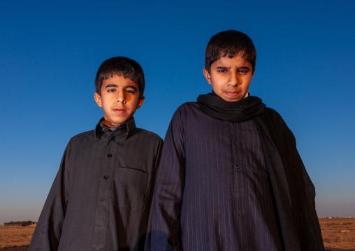 Portrait of two saudi boys, Al Madinah Province, Al-Ula, Saudi Arabia