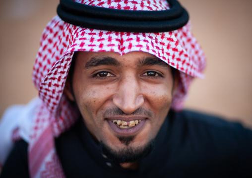 Portrait of a smiling saudi man wearing a kaffiyeh, Al-Jawf Province, Sakaka, Saudi Arabia
