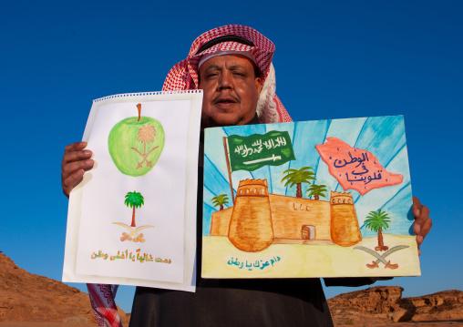 Saudi teacher shwing the drawings of his pupils, Al Madinah Province, Al-Ula, Saudi Arabia
