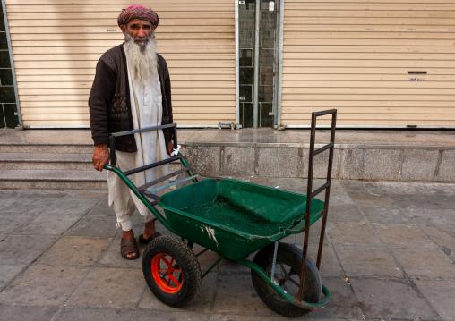 Old man with a long beard pushing a cart in the street, Makkah province, Taif, Saudi Arabia
