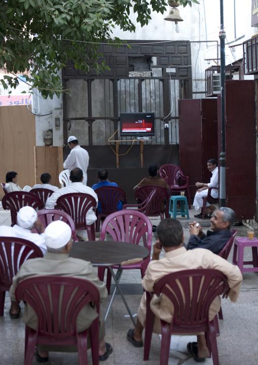 Men watching tv in a coffee in Al Balad, Mecca province, Jeddah, Saudi Arabia